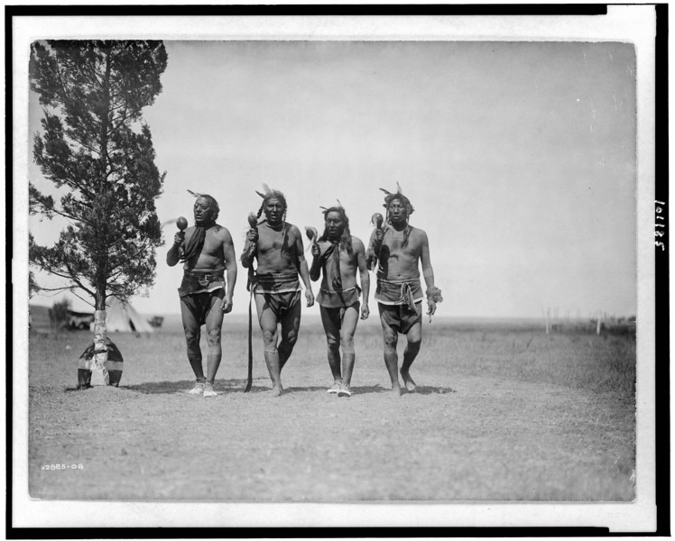 Description of  Title: Night medicine men.  <br />Date Created/Published: 1908, c1908.  <br />Summary: Arikara medicine ceremony with four night men dancing.  <br />Photograph by Edward S. Curtis, Curtis (Edward S.) Collection, Library of Congress Prints and Photographs Division Washington, D.C.