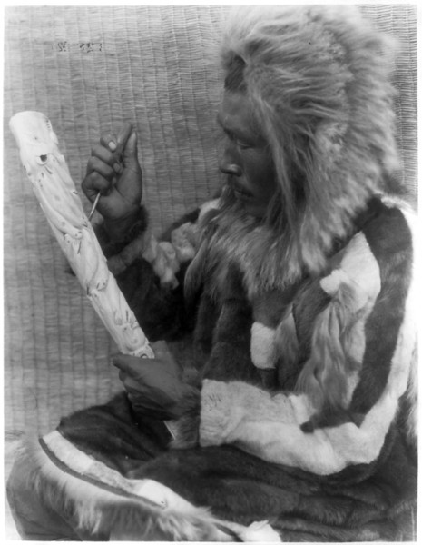 Description of  Title: The ivory carver--Nunivak.  <br />Date Created/Published: c1929 February 28.  <br />Photograph by Edward S. Curtis, Curtis (Edward S.) Collection, Library of Congress Prints and Photographs Division Washington, D.C.