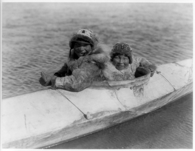 Description of  Title: Boys in a kaiak (i.e., kayak)--Nunivak.  <br />Date Created/Published: c1929 February 28.  <br />Photograph by Edward S. Curtis, Curtis (Edward S.) Collection, Library of Congress Prints and Photographs Division Washington, D.C.