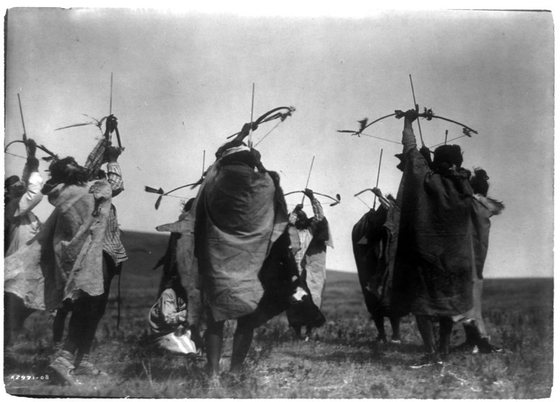 Description of  Title: The flight of arrows.  <br />Date Created/Published: c1908.  <br />Summary: Atsina crazy dance, Indians shooting arrows toward sky.  <br />Photograph by Edward S. Curtis, Curtis (Edward S.) Collection, Library of Congress Prints and Photographs Division Washington, D.C.