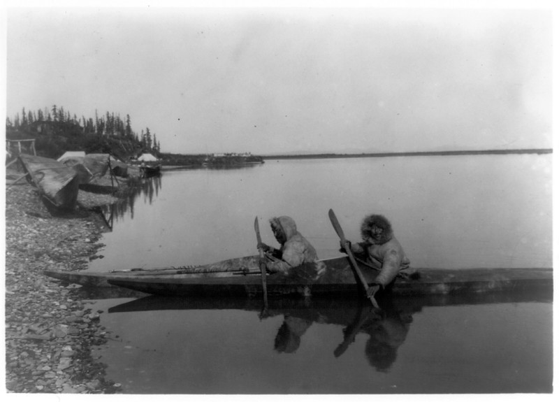Description of  itle: At Noatak village.  <br />Date Created/Published: c1929.  <br />Summary: Two Eskimos in kayak.  <br />Photograph by Edward S. Curtis, Curtis (Edward S.) Collection, Library of Congress Prints and Photographs Division Washington, D.C.