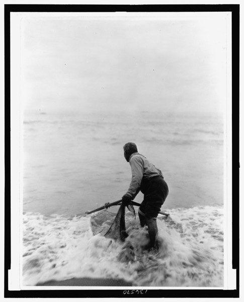 Description of  Title: The smelt fisher--Trinidad Yurok.  <br />Date Created/Published: c1923 Jun. 30.  <br />Summary: Photograph shows a Yurok man fishing with a net, probably in the Trinidad area of California.  <br />Photograph by Edward S. Curtis, Curtis (Edward S.) Collection, Library of Congress Prints and Photographs Division Washington, D.C.
