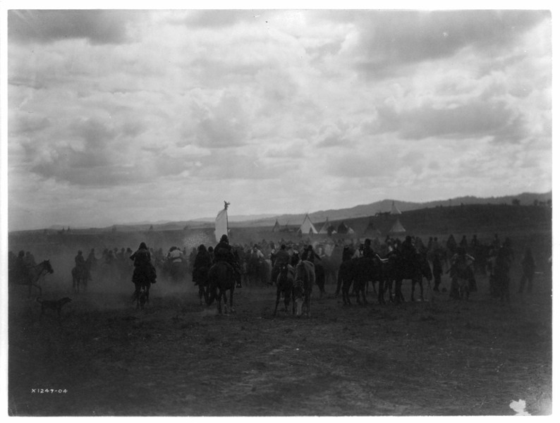 Description of  Title: Jicarilla fiesta.  <br />Date Created/Published: c1905.  <br />Summary: Jicarilla Apaches, most on horse back, moving toward encampment.  <br />Photograph by Edward S. Curtis, Curtis (Edward S.) Collection, Library of Congress Prints and Photographs Division Washington, D.C.