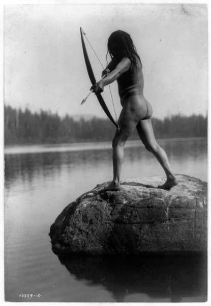 Description of  Title: The Bowman--Nootka.  <br />Date Created/Published: c1910.  <br />Summary: Rear view of nude Indian standing on rock in water and aiming arrow.  <br />Photograph by Edward S. Curtis, Curtis (Edward S.) Collection, Library of Congress Prints and Photographs Division Washington, D.C.