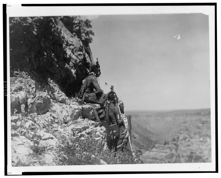 Description of  Title: Rigid and statuesque.  <br />Date Created/Published: c1905.  <br />Summary: Three Crow men, facing right, on rock ledge.  <br />Photograph by Edward S. Curtis, Curtis (Edward S.) Collection, Library of Congress Prints and Photographs Division Washington, D.C.