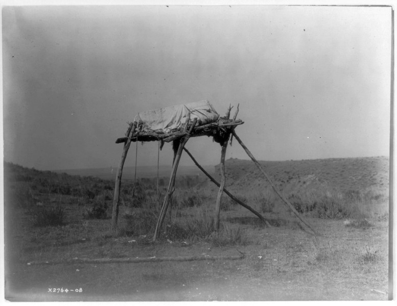 Description of  Title: A burial platform--Apsaroke.  <br />Date Created/Published: c1908 July 6.  <br />Photograph by Edward S. Curtis, Curtis (Edward S.) Collection, Library of Congress Prints and Photographs Division Washington, D.C.