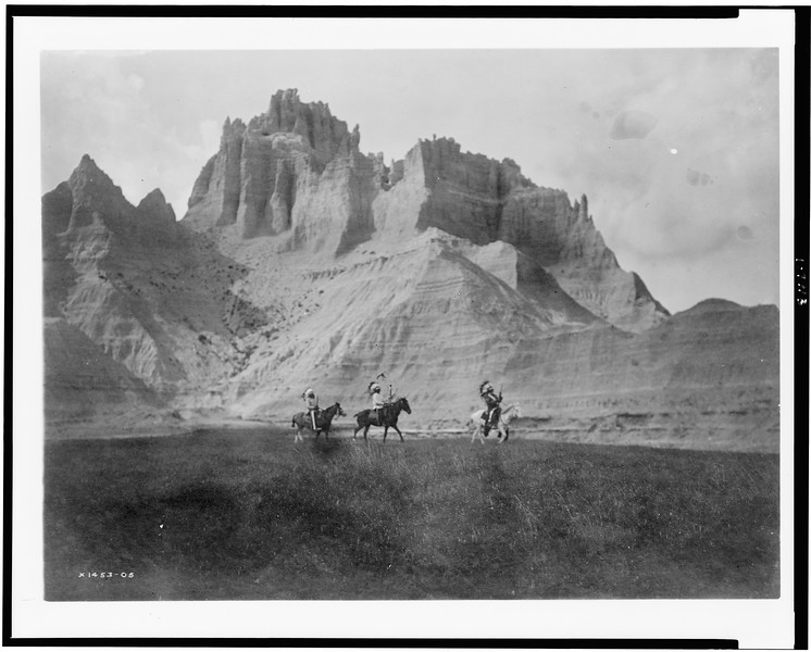 Description of  Title: [Entering the Bad Lands. Three Sioux Indians on horseback].  <br />Date Created/Published: c1905.  <br />Photograph by Edward S. Curtis, Curtis (Edward S.) Collection, Library of Congress Prints and Photographs Division Washington, D.C.