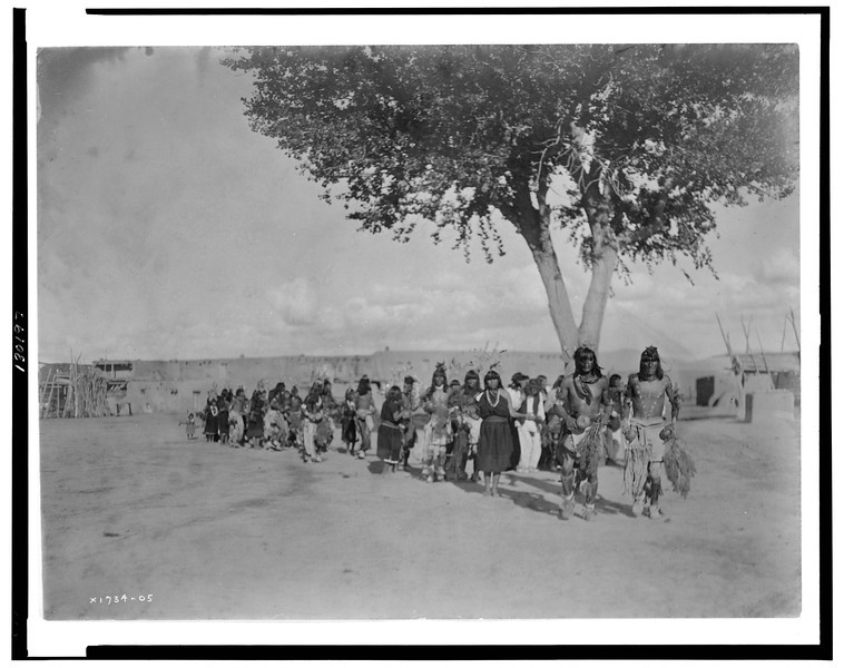 Description of  Title: Tablita Dance.  <br />Date Created/Published: c1905.  <br />Summary: Tewa Indians dancing in line formation.  <br />Photograph by Edward S. Curtis, Curtis (Edward S.) Collection, Library of Congress Prints and Photographs Division Washington, D.C.