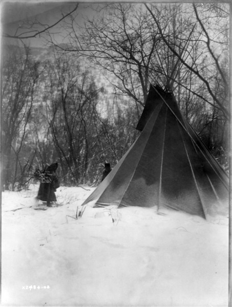 Description of  Title: When winter comes.  <br />Date Created/Published: c1908 July 6.  <br />Summary: Dakota woman, carrying firewood in snow, approaches tipi.  <br />Photograph by Edward S. Curtis, Curtis (Edward S.) Collection, Library of Congress Prints and Photographs Division Washington, D.C.