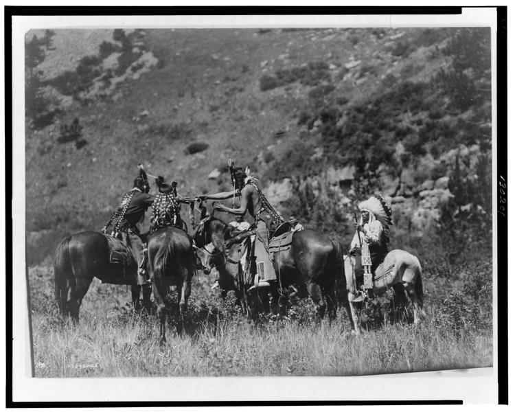 Description of  Title: A swap.  <br />Date Created/Published: c1905.  <br />Summary: Crow men on horseback apparently involved in an exchange.  <br />Photograph by Edward S. Curtis, Curtis (Edward S.) Collection, Library of Congress Prints and Photographs Division Washington, D.C.