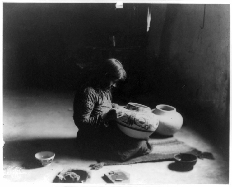 Description of  Title: Nunipayo decorating pottery.  <br />Date Created/Published: c1900.  <br />Summary: Woman seated on mat painting designs on pottery.  <br />Photograph by Edward S. Curtis, Curtis (Edward S.) Collection, Library of Congress Prints and Photographs Division Washington, D.C.