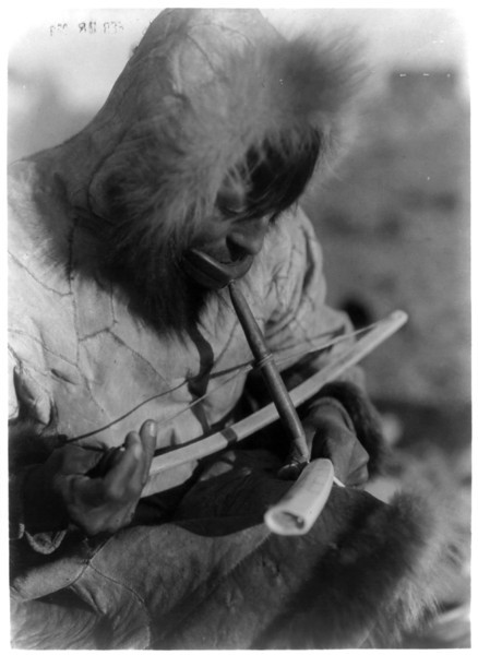 Description of  Title: Drilling ivory--King Island.  <br />Date Created/Published: c1929 February 28.  <br />Summary: Eskimo man, wearing hooded parka, manually drilling an ivory tusk.  <br />Photograph by Edward S. Curtis, Curtis (Edward S.) Collection, Library of Congress Prints and Photographs Division Washington, D.C.