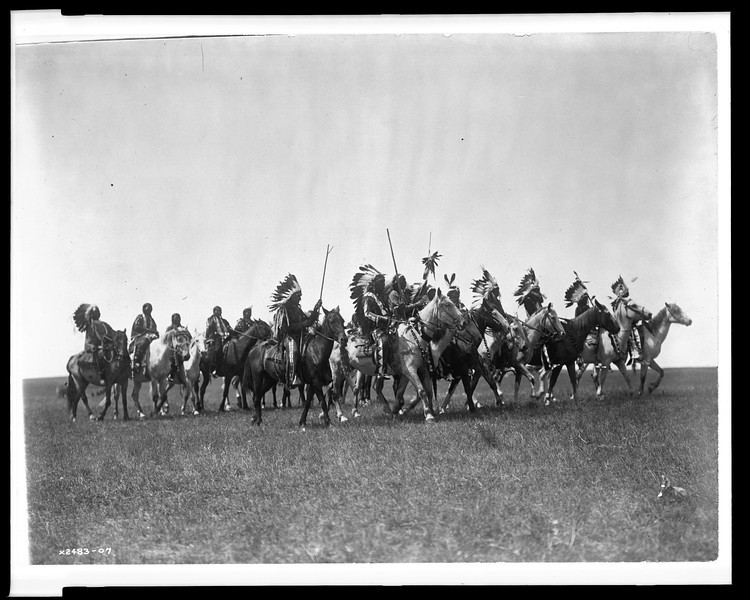 Description of  Title: Brulé war party.  <br />Date Created/Published: c1907 December 26.  <br />Summary: Brulé Indians, many wearing war bonnets, on horseback.  <br />Photograph by Edward S. Curtis, Curtis (Edward S.) Collection, Library of Congress Prints and Photographs Division Washington, D.C.