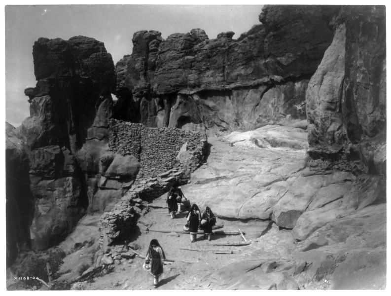 Description of  Title: Acoma roadway  <br />Date Created/Published: c1905.  <br />Summary: Group of Acoma women, carrying pottery vessels, descending between rock formations.  <br />Photograph by Edward S. Curtis, Curtis (Edward S.) Collection, Library of Congress Prints and Photographs Division Washington, D.C.