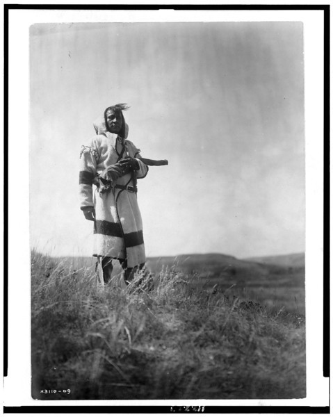 Description of  Title: Piegan scout.  <br />Date Created/Published: c1910.  <br />Summary: Piegan man stands with open prairie behind him.  <br />Photograph by Edward S. Curtis, Curtis (Edward S.) Collection, Library of Congress Prints and Photographs Division Washington, D.C.