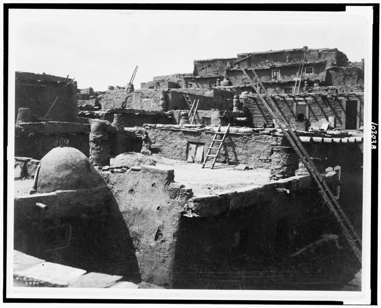 Description of  Title: [The terraced houses of Zuni].  <br />Date Created/Published: c1903.  <br />Summary: Adobe buildings.  <br />Photograph by Edward S. Curtis, Curtis (Edward S.) Collection, Library of Congress Prints and Photographs Division Washington, D.C.