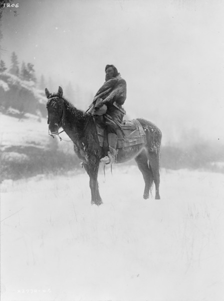 Description of  Title: The scout in winter--Apsaroke.  <br />Date Created/Published: c1908 July 6.  <br />Summary: Apsaroke man on horseback on snow-covered ground, probably in Pryor Mountains, Montana.  <br />Photograph by Edward S. Curtis, Curtis (Edward S.) Collection, Library of Congress Prints and Photographs Division Washington, D.C.
