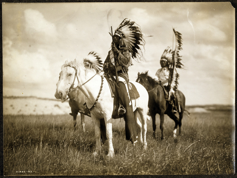 Description of  Title: Sioux chiefs.  <br />Date Created/Published: c1905.  <br />Summary: Photograph shows three Native Americans on horseback.  <br />Photograph by Edward S. Curtis, Curtis (Edward S.) Collection, Library of Congress Prints and Photographs Division Washington, D.C.