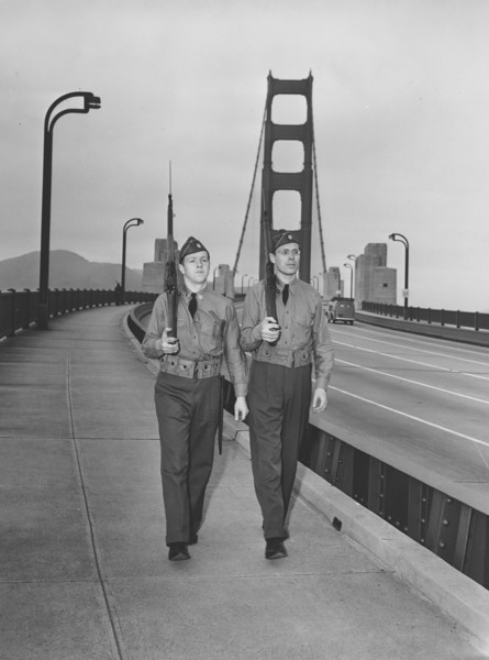 Description of  Two armed guards patrol along the Golden Gate Bridge in San Francisco, as a precaution against possible sabotage acts, December 10, 1941.  (AP Photo)