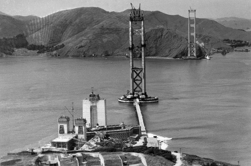 Description of  The construction of the Golden Gate Bridge, which would link Fort Point, bottom, with Marin County, Calif., top, is seen as work progressed, 1934.  (AP Photo/Redwood Empire Association)