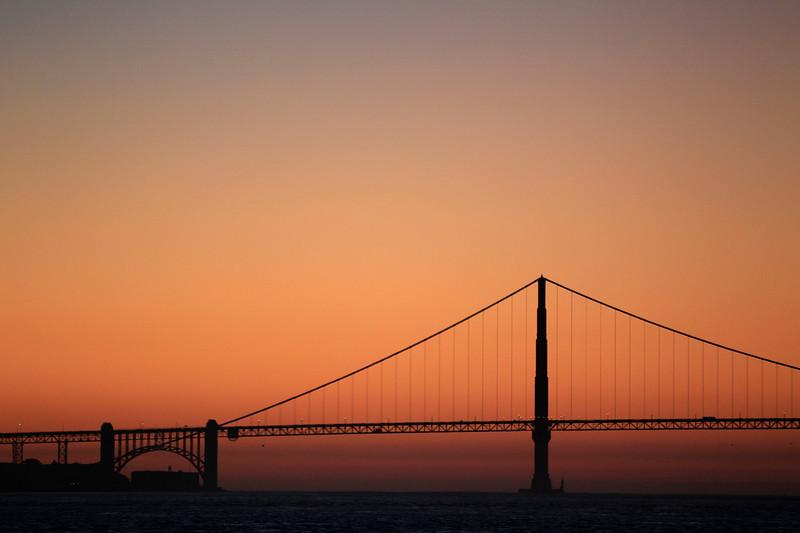 Description of  The Golden Gate Bridge is seen at sunset in San Francisco,  Wednesday, Jan. 11, 2012. (AP Photo/Marcio Jose Sanchez)