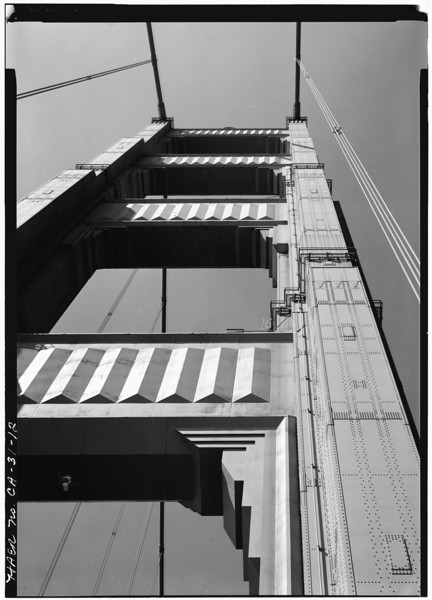 Description of  A detail view of a tower on the Golden Gate Bridge, looking up from the bridge deck, 1984. (Photo by Jet Lowe, Library of Congress)