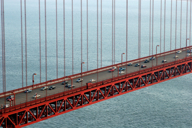 Description of  The Golden Gate Bridge is pictured December 20, 2006 in San Francisco, California. The Golden Gate Bridge is a suspension bridge spanning the Golden Gate, the opening into San Francisco Bay from the Pacific Ocean. It connects the city of San Francisco on the northern tip of the San Francisco Peninsula to Marin County as part of US Highway 101 and California State Highway 1. The largest suspension bridge in the world when it was completed in 1937, it has become an internationally recognized symbol of San Francisco and America. (GABRIEL BOUYS/AFP/Getty Images)