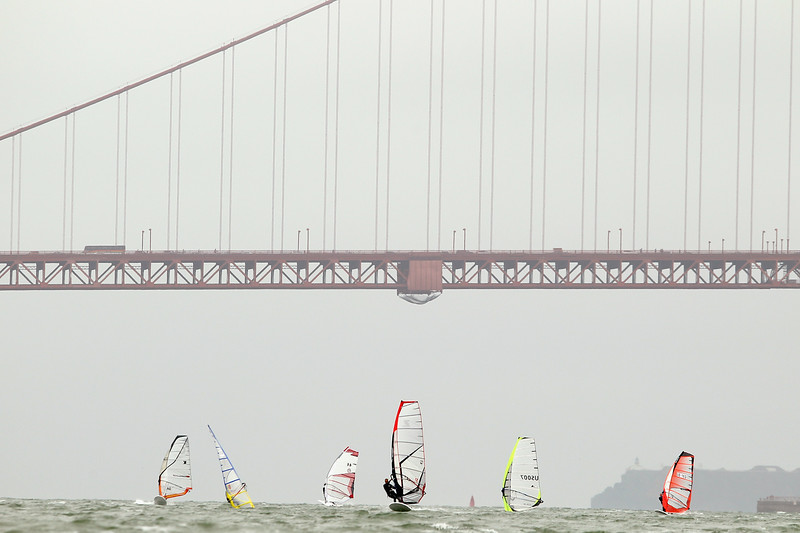 Description of  Athletes sail near the Golden Gate Bridge during day 1 of the US Windsurfing National Championships hosted by the St. Francis Yacht Club on July 20, 2010 in San Francisco, California.  (Photo by Ezra Shaw/Getty Images)