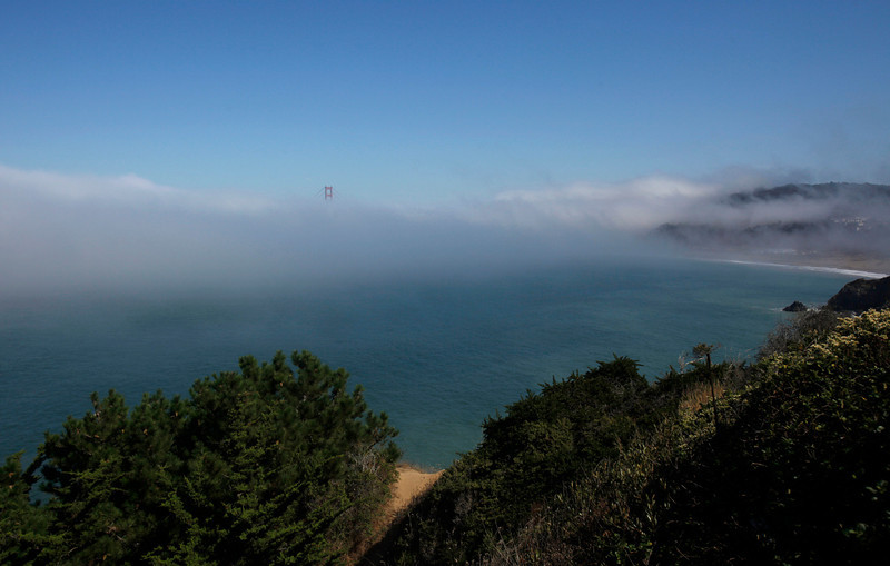 Description of  A span of the Golden Gate Bridge is seen through fog from Land's End in San Francisco, Wednesday, Sept. 29, 2010. (AP Photo/Jeff Chiu)