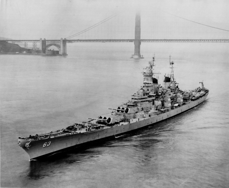 "Description of  The battleship ""Missouri"" creeps under a fog enshrouded Golden Gate Bridge on Sept. 10, 1954, to begin a three day open house visit to his port city. The 58,000-ton vessel, aboard which the Japanese surrender was signed Sept. 2, 1945, was heading for the mothball fleet at Bremerton, Wash. (AP-Photo/U.S. Navy)"