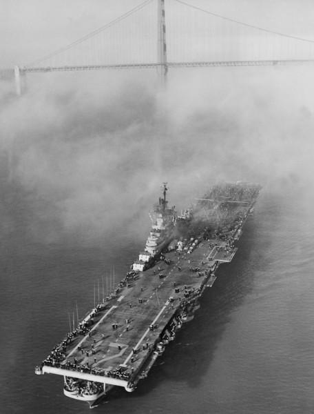 Description of  The aircraft carrier U.S.S. Boxer creeps through the fog under the Golden Gate Bridge in San Francisco as it arrives from Korean waters, Sept. 25, 1952. It was the Boxer from which the Navy launched drone aircraft for an attack on Communist concentrations in Korea. Aboard the ship were more than 2,500 men of Air group two. She will later go to Hunter's Point, a South San Francisco Naval Base for complete overhaul. (AP Photo)