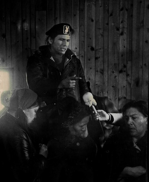 Description of  MAR 3 1973 - Dennis Banks, Aim national field director, tells women residents of Wounded Knee, S.D., that they are in the middle of a war, one he promised the Indians eventually will win. (Dave Buresh/The Denver Post)