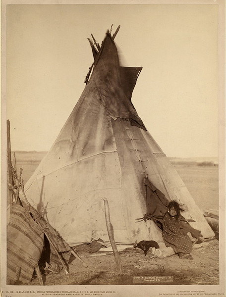 Description of  A young Oglala girl sitting in front of a tipi, with a puppy beside her, probably on or near Pine Ridge Reservation. 1891. Grabill, John C. H., photographer. (Library of Congress Prints and Photographs Division)