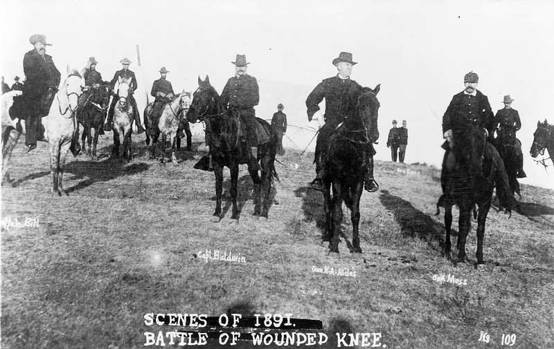 "Description of  ""Scenes of 1891 - Battle of Wounded Knee."" Buffalo Bill, Capt. Baldwin, Gen. Nelson A. Miles, Capt. Moss, and others, on horseback, on battlefield of Wounded Knee. Ca. 1890. (Library of Congress Prints and Photographs Division)"