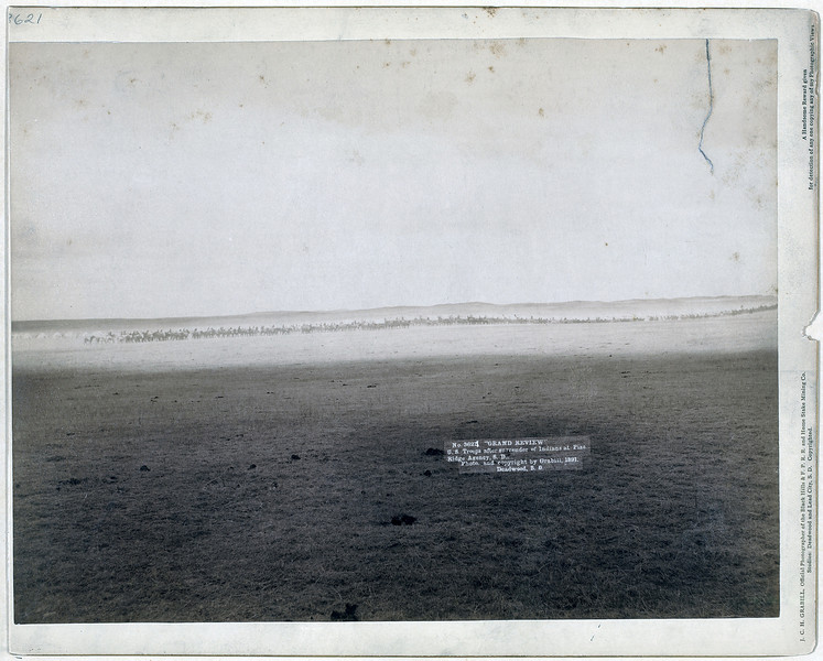 "Description of  Title: ""Grand review."" U.S. troops after surrender of Indians at Pine Ridge Agency, S.D.<br />Very distant view of a line of military men on horseback. 1891.<br />Repository: Library of Congress Prints and Photographs Division Washington, D.C. 20540"