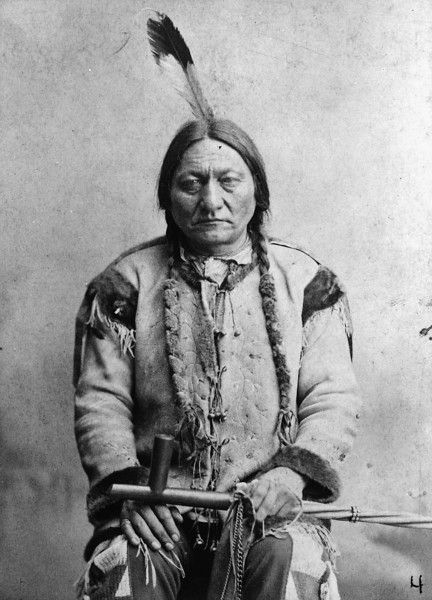 Description of  Sitting Bull c1884. Sitting Bull was shot and killed when police tried to arrest him outside his house on the Standing Rock reservation on December 15, 1890. After his death, members of his Hunkpapa band followed Chief Spotted Elk to Wounded Knee. Palmquist & Jurgens, photographer. (Denver Public Library; Western History Collection)
