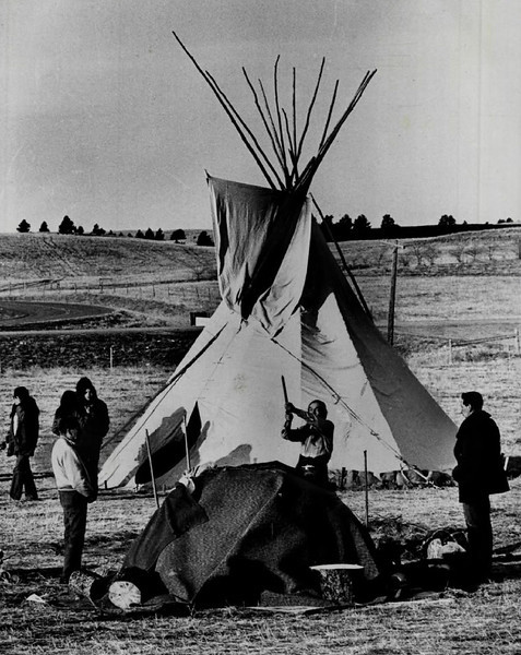 Description of  MAR 5 1973 - Members Of American Indian Movement Perform An Indian Ceremony Sunday at a Tepee. The tepee was later moved to site away from Wounded Knee where Indian representatives and federal officials met. (Dave Buresh/The Denver Post)