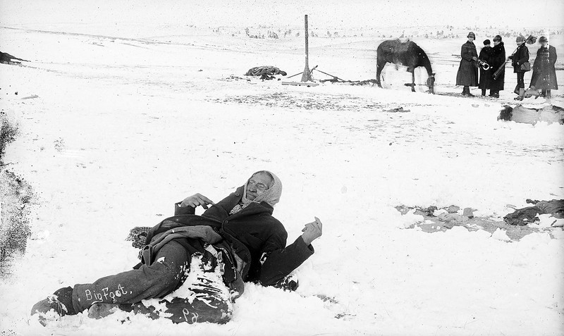 "Description of  ""Miniconjou chief Spotted Elk (aka. Bigfoot) lies dead in the snow after massacre at Wounded Knee. Trager and Kuhn, photographer/Northwestern Photo Co., Chadron, Nebraska. (Denver Public Library; Western History Collection)"