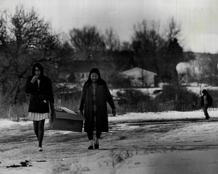 Description of  FEB 2 1968 - Woman carry home the groceries in this Indian country scene in South Dakota. Note the contrasting skirt lengths of the two Indian women. (Dave Buresh/The Denver Post)