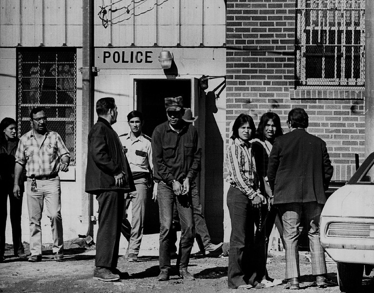 Description of  MAR 3 1973 - Four Persons Removed from The Jail at Pine Ridge, S.D. The four, arrested Friday night, were taken Saturday to the jail at Rapid City, S.D. (Dave Buresh/The Denver Post)