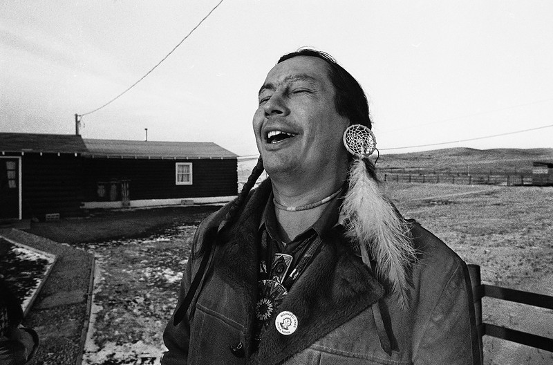 "Description of  American Indian Movement leader Russell Means, who is challenging incumbent Oglala Sioux Tribal President Richard Wilson in Thursday's election on the Pine Ridge Indian Reservation, laughs at news report which quoted Wilson as saying he will give AIM 10 days to get off the reservation after he is reelected ""or else"". (AP Photo/Jim Mone)"