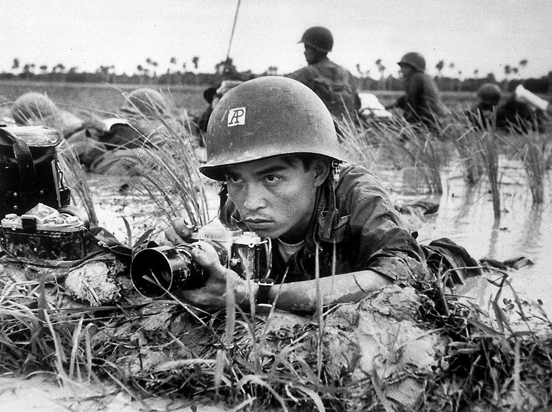 Description of  The Associated Press photographer Huynh Thanh My covers a Vietnamese battalion pinned down in a Mekong Delta rice paddy about a month before he was killed in combat on Oct. 10, 1965. (AP PHOTO)