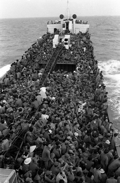 Description of  South Vietnamese troops fill every available space on a ship evacuating them from Thuan An beach, near Hue, to Da Nang as Communist troops advanced in March, 1975.  (AP Photo/Cung)