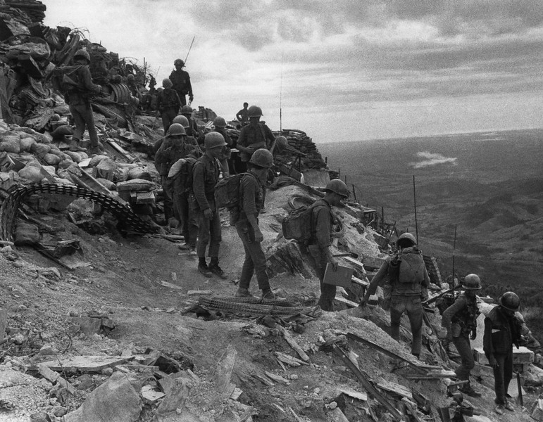 Description of  South Vietnamese troops move out on patrol from Firebase Fuller, a hilltop position four miles south of the demilitarized zone, Vietnam on July 20, 1971. (AP Photo/Jacques Tonnaire)
