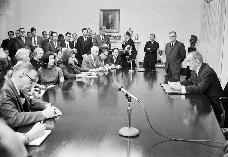 Description of  President Johnson prepares to open a news conference February 2, 1968 in the White House Cabinet room. He told reporters that the military phases of the Communist offensives in Vietnam had failed.  (AP Photo)