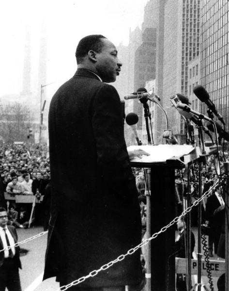 "Description of  Rev. Dr. Martin Luther King Jr., leads a crowd of 125,000 Vietnam War protesters in front of the United Nations in New York on April 15, 1967, as he voices a repeated demand to ""Stop the bombing.""   (AP Photo)"