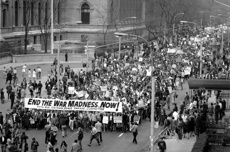 "Description of  Anti-Vietnam war protesters march down Fifth Avenue near to 81st Street in New York City on April 27, 1968, in protest of the U.S. involvement in the Vietnamese war.  The demonstrators were en route to nearby Central Park for mass ""Stop the war"" rally. (AP Photo)"