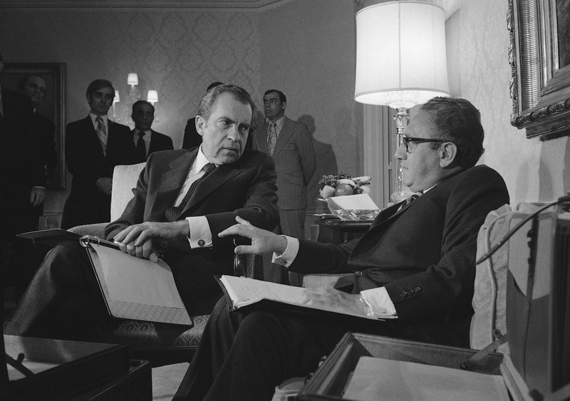 Description of  President Nixon confers with Henry A. Kissinger in New York on Nov. 25, 1972, after the presidential adviser returned from a week of secret negotiations in Paris with North Vietnam's Le Duc Tho. Documents released Tuesday, Dec. 2, 2008, from the Nixon years shed new light on just how much the Nixon White House struggled with growing public unrest over the protracted war in Vietnam. (AP Photo)