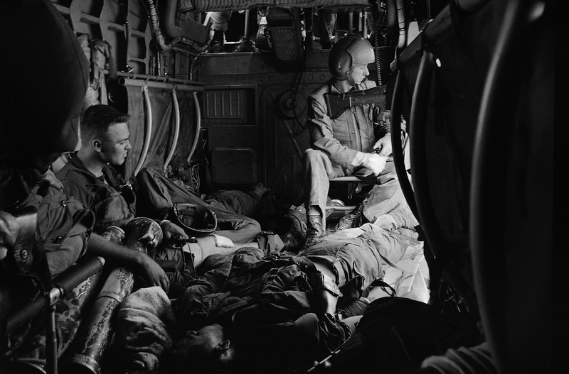 Description of  Wounded marines lie about the floor of a H34 helicopter, August 19, 1965 as they were evacuated from the battle area on Van Tuong peninsula. (AP Photo)