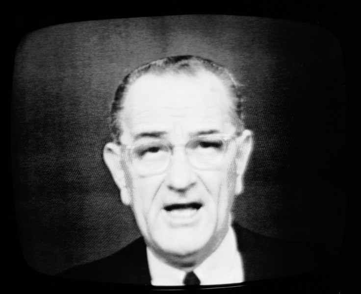 Description of  President Lyndon Johnson speaks during a televised address from the White House, Jan. 31, 1966, announcing the resumption of bombing of targets in North Vietnam. The president, who was photographed from a television screen at the New York studios of NBC-TV, said he was requesting Amb. Arthur Goldberg to call for an immediate meeting of the U.N. Security Council. (AP Photo/Marty Lederhandler)